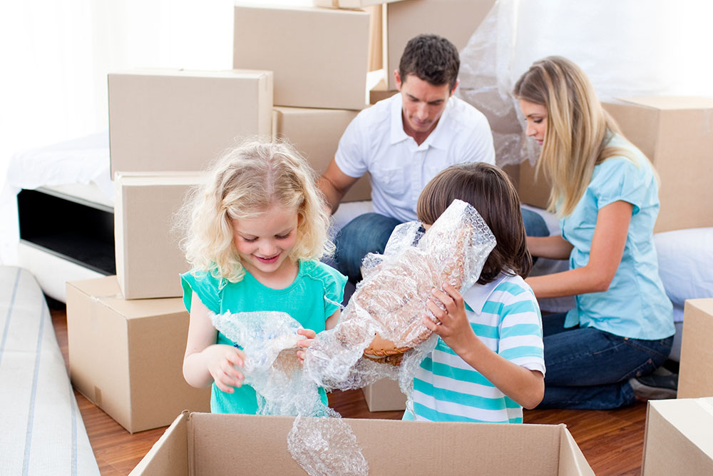 bigstock-Animated-Family-Packing-Boxes-7137775.jpg
